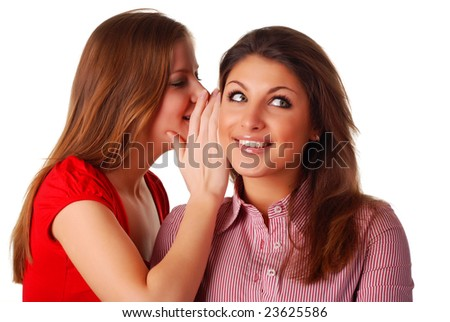 two beautiful happy young friends are whispering - stock photo