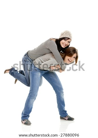 Two beautiful happy young woman isolated on white - stock photo