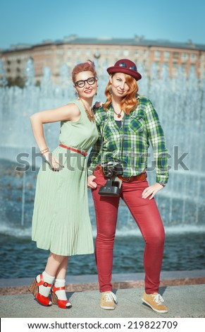 Two beautiful hipster girls - stock photo