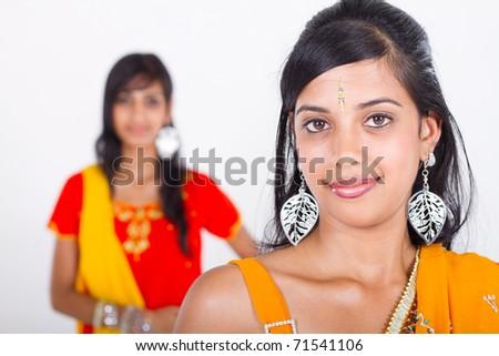two beautiful indian girl in studio - stock photo