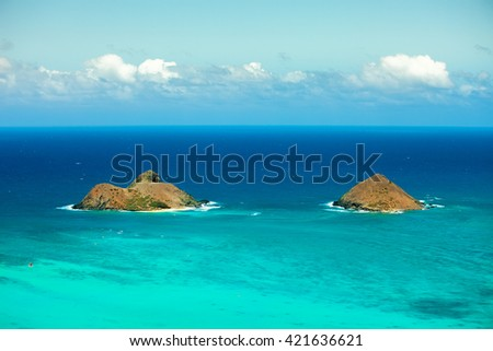 Two beautiful islands on a calm day perfect for water-sports and relaxation - stock photo
