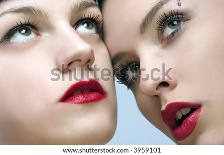 two beautiful ladies with sensual red lips - stock photo