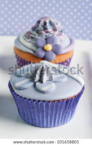 two beautiful lilac cupcake for wedding card or mothers day - stock photo