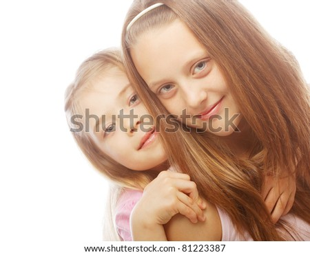 two beautiful little girls on a white background
