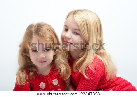 two beautiful little girls on a white background - stock photo