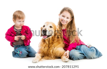 two beautiful little girls with a red retriever - stock photo