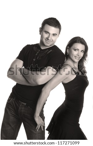 Two beautiful lovers in an artistic photo shoot - stock photo