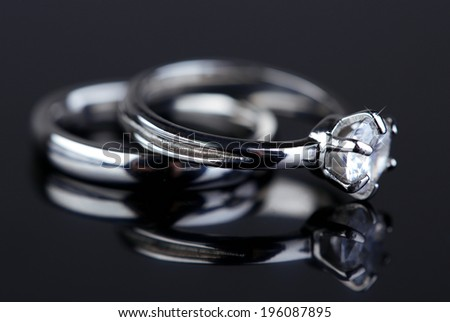 Two beautiful rings on gray background - stock photo