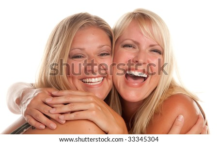 Two Beautiful Sister Laughing Isolated on a White Background. - stock photo