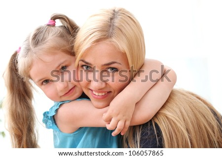 Two beautiful sisters at home - stock photo