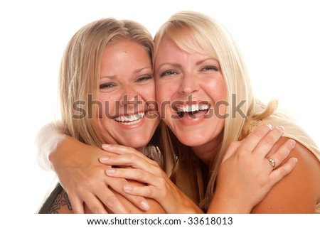 Two Beautiful Sisters Laughing Isolated on a White Background. - stock photo