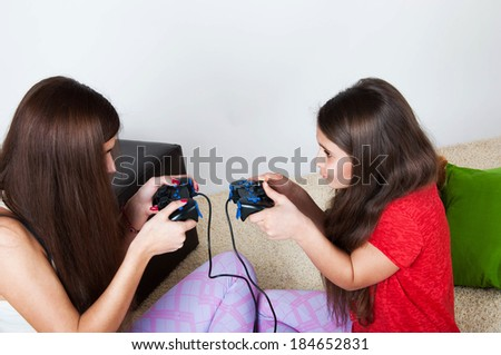 two beautiful sisters play together