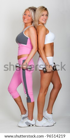 Two beautiful sisters working out together - stock photo