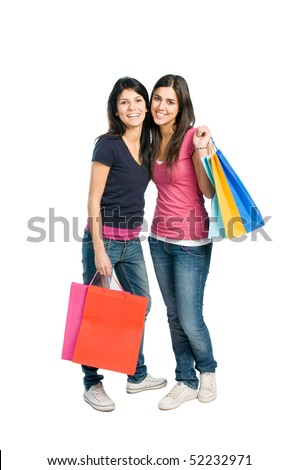 Two beautiful smiling young brunette women doing shopping isolated on white background - stock photo