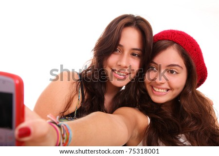 Two beautiful teen posing for the camera  of your cell - stock photo