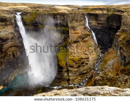 Two beautiful waterfalls in Iceland - Haifoss, second tallest waterfall, and Granni. - stock photo