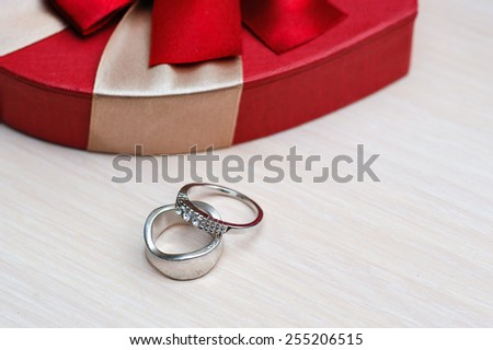 Two beautiful wedding rings on the table. - stock photo