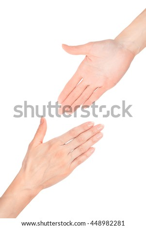 Two beautiful woman`s hands reaching each other. Isolated on white with clipping path