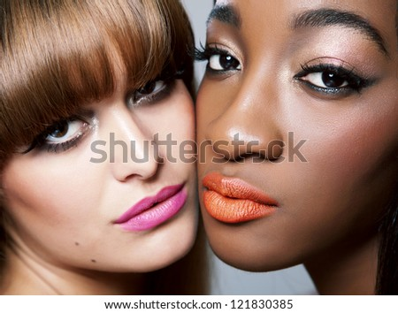 Two beautiful woman with perfect skin close together - stock photo