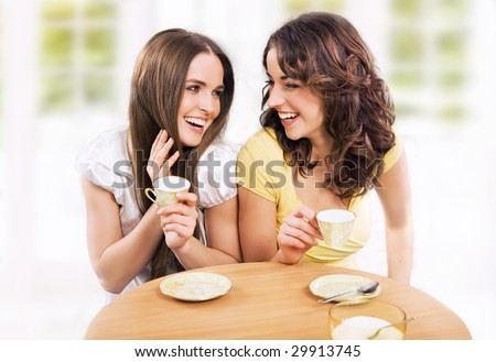 Two beautiful women chatting - stock photo