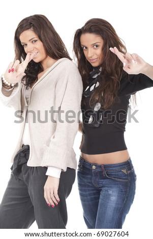 two beautiful women having fun and crossing fingers - stock photo