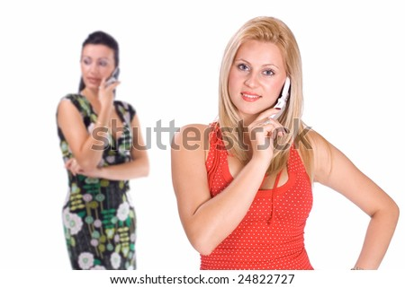 Two beautiful women holding phone, with shallow depth of field (doff). Studio shot.