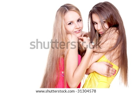 two beautiful women in a colored dress on a white background isolated