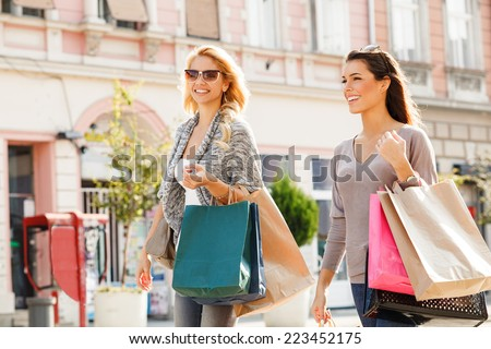 Two beautiful women in shopping. Selective focus on brunette. - stock photo