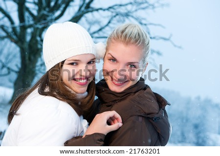 Two beautiful women in winter clothing outdoors