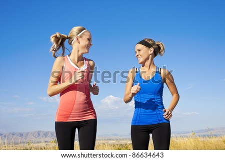 Two beautiful Women Jogging Together - stock photo