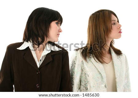 Two beautiful young business woman looking to the right.