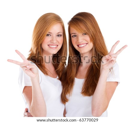 two beautiful young teen girl giving victory hand sign