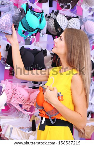 Two beautiful young woman in shop with underwear - stock photo