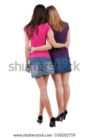 Two beautiful young woman l. Rear view. Isolated over white.