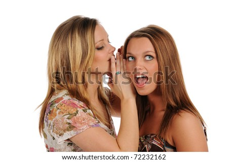 Two Beautiful young Women sharing a secret isolated on a white background - stock photo