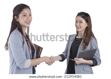 Two beauty businesswomen handshaking smiling on white background