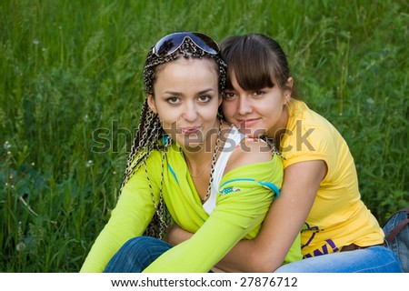 two beauty girls on the plants background - stock photo