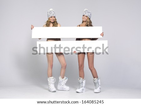 Two beauty woman only in hat and shoes with boards
