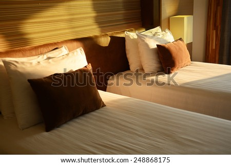 Two beds in a hotel room. - stock photo