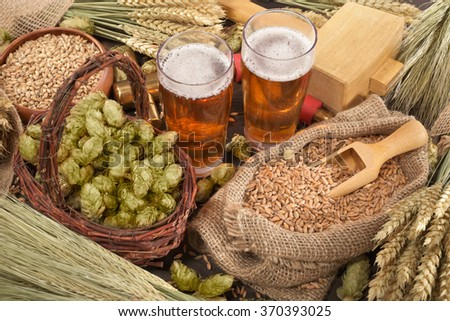 two beer glasses, hammer, spigot with hops, wheat, grain, barley and malt