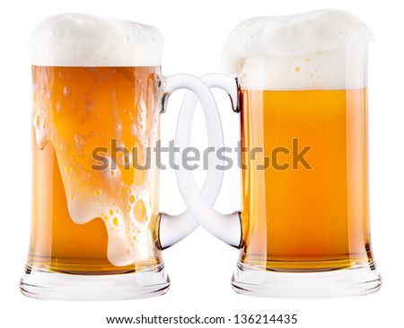 Two beer mugs being attached to each other. The glasses ( Mass of beer ) are typical for the Octoberfest in Munich - stock photo