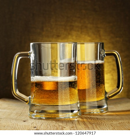 Two beer mugs on wooden table