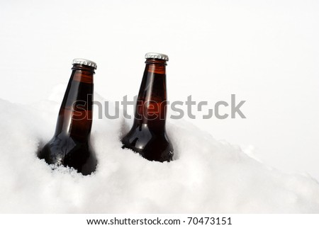 two beers in the snow - stock photo