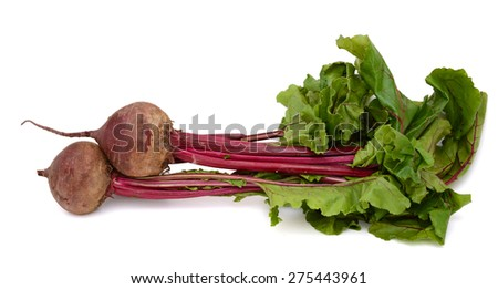 two beets and green leaves on white background  - stock photo