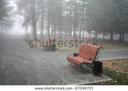 Two benches in a park - stock photo