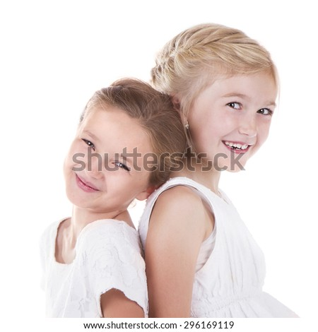 Two best friends sitting back to back isolated on a white background - stock photo