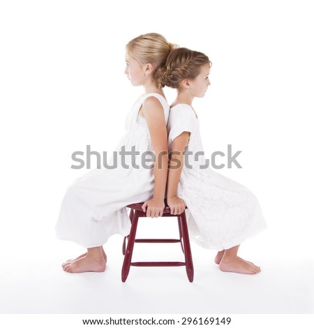 Two best friends sitting back to back isolated on a white background