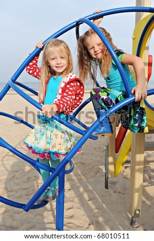 Two best girlfriends playing on the playground - stock photo
