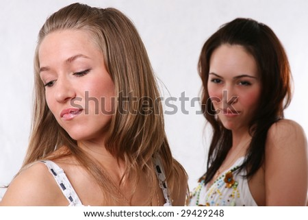 two best girlfriends, the blonde and the brunette - stock photo