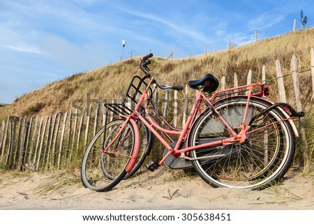 Two bicycles at the beach in North Holland, Netherlands - stock photo